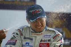 GT podium: champagne shower for Sascha Maassen