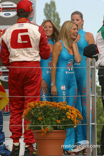Podium: Michel Jourdain Jr. offers champagne to the Molson Dry girls