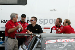Tom Milner (l) talks to his crew after Friday's practice session at Laguna Seca Raceway