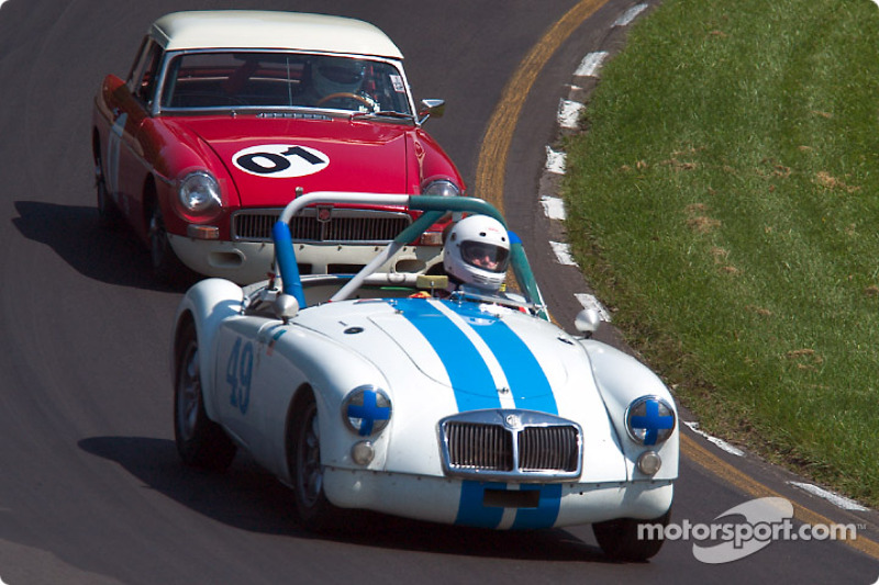 #49 1962 MGA Roadster, owned by David Smith leads #01 1964 MGB Coupe, owned by Alan Tosler