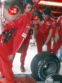 Ross Brawn inspects tires