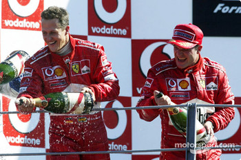 Podium: champagne for Michael Schumacher and Rubens Barrichello
