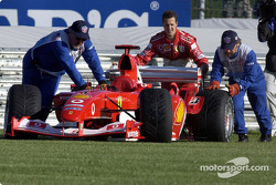 Michael Schumacher pushes his Ferrari