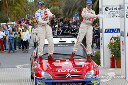 Rally winners Daniel Elena and Sébastien Loeb at the finish podium