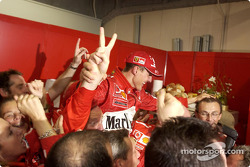 Michael Schumacher celebrates sixth world championship with Ferrari team members