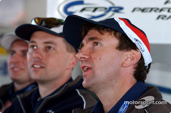 Glenn Seton watches the progress of Craig Lowndes on the monitor