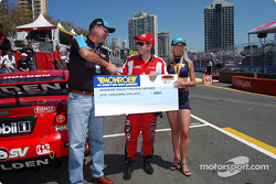 Todd Kelly accepts the cheque and plaque after capturing his first career pole