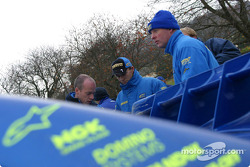 Petter Solberg and team discus tactics