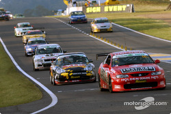 The field bunches behind the #05 Garry Rogers Motorsport Holden Monaro CV8: Peter Brock, Greg Murphy, Jason Bright, Todd Kelly, after the safety car