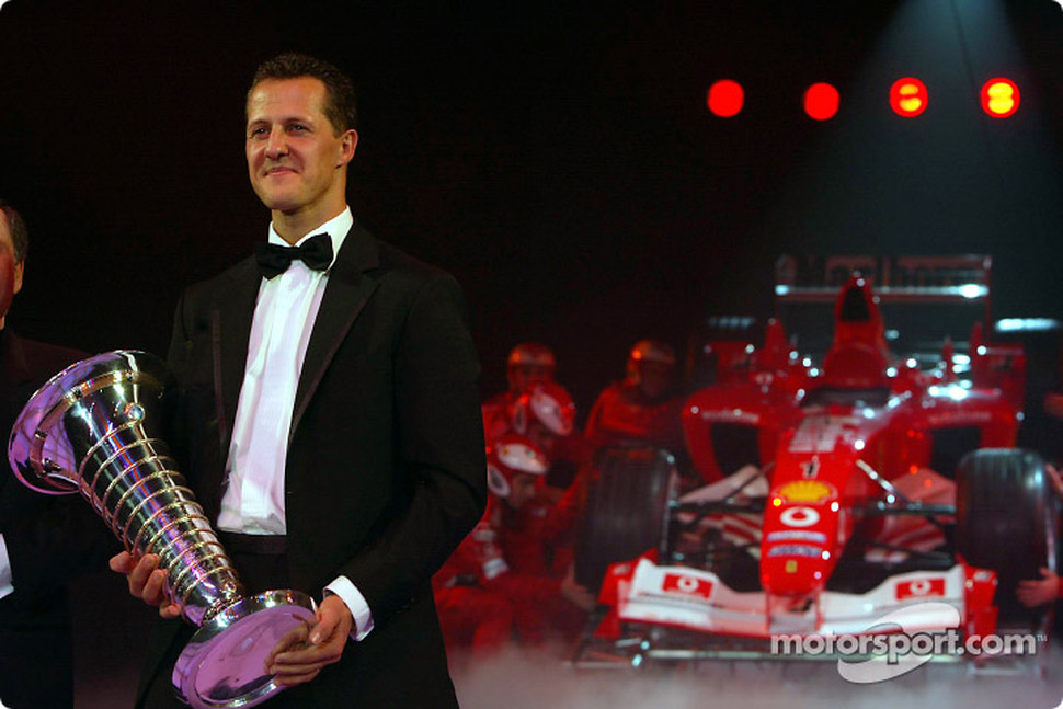 Formula One World Champion Michael Schumacher and Jean Todt with the Ferrari F2003 GA
