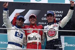 Podium: race winner Michael Schumacher with Juan Pablo Montoya and Jenson Button