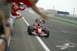 Michael Schumacher celebrates victory