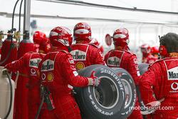 Ferrari team members wait for Michael Schumacher