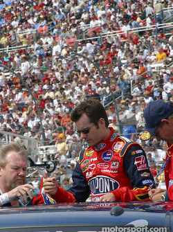 Jeff Gordon signs an autograph