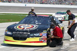 Goodyear tire techs check the temp of Johnny Benson's car