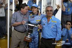 Jarno Trulli celebrates victory with Patrick Faure and Flavio Briatore