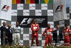Podium: race winner Michael Schumacher with Ralf Schumacher and Rubens Barrichello