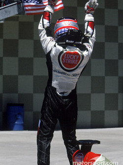 Takuma Sato celebrates third place finish