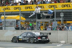 Gary Paffett takes the checkered flag