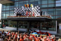 Podium: race winner Michael Schumacher with Fernando Alonso and Rubens Barrichello