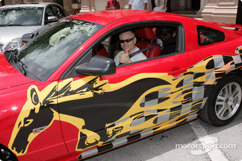 Mark Martin sits in the driver's seat of a special 2005 Ford Mustang GT, the official pace car for the Ford championship weekend