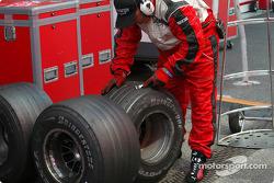 Bridgestone technician checks tires after pitstop