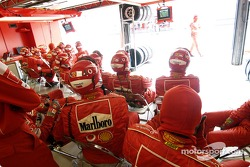 Ferrari team members wait for next pitstop