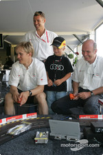 Mattias Ekström, Tom Kristensen and Dr Wolfgang Ullrich have fun with the Audi slotcar track