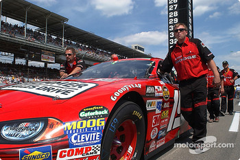 Jeremy Mayfield's crew pushes the #19 onto the grid