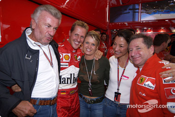 Michael Schumacher celebrates 7th World Championship with Willi Webber, wife Corinna and Jean Todt