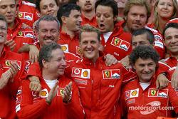 F1: Michael Schumacher celebrates 7th World Drivers Championship with Ferrari team members