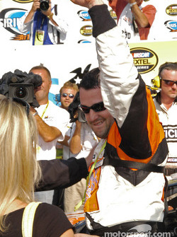 Tony Stewart takes victory but in agony