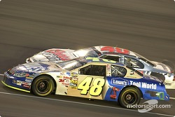 Jimmie Johnson passes Sterling Marlin on the exit of pitroad