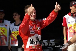 Rubens Barrichello celebrates pole
