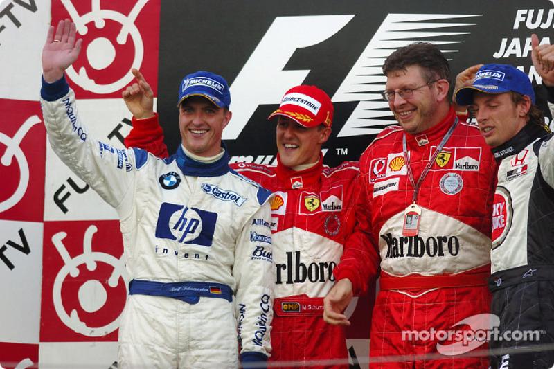 Podium: racewinnaar Michael Schumacher met Ralf Schumacher, Ross Brawn en Jenson Button