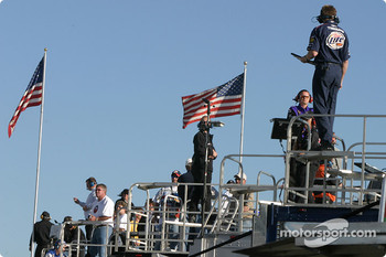 Crew chiefs monitor practice action from atop the team transporters