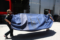 Parts of the Red Bull Racing are taken to the garage
