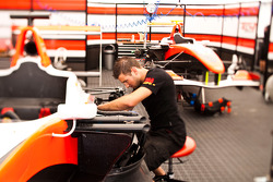 Mechanic works on the car of Jean-Eric Vergne,