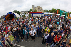 Fans wait for the Team Peugeot cars to unload