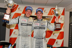 Jamie Campbell-Walter and Warren Hughes receive their trophy for their Silverstone victory