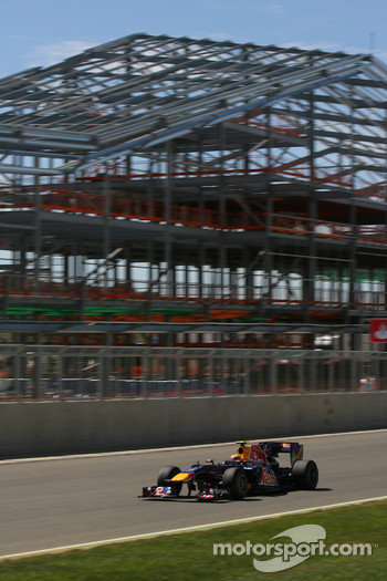 Mark Webber, Red Bull Racing in front of the new pit building