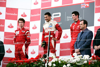 Daniel Morad celebrates on the podium with Mirko Bortolotti and Alexander Rossi