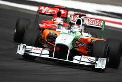 Adrian Sutil, Force India F1 Team leads Timo Glock, Virgin Racing