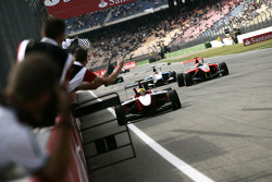 Esteban Gutierrez celebrates victory in front of the team