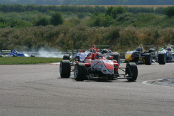 Through the Club Chicane, with Oli Web in front