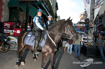 Police forces on horses at the Ford Racing Festival on Crescent Street