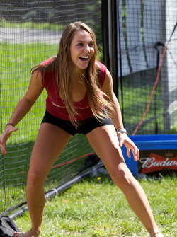 A charming Budweiser girl plays football challenge