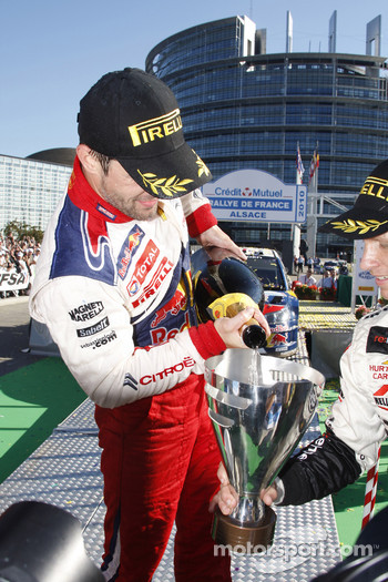 Podium: Sébastien Loeb, Citroën C4, Citroën Total World Rally Team