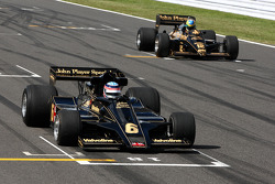 Takuma Sato drives the 1976 Lotus Ford of Gunnar Nilson, Bruno Senna, Hispania Racing F1 Team drives the 1986 Lotus Renault Turbo of Ayrton Senna