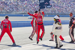 Stewart-Haas Racing Chevrolet crew members celebrate the victory of Tony Stewart